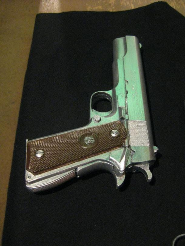 "Resin replica 1911 pistol made for Portland Stage's ""Trouble is My Business."" Art by The Shoggoth Assembly. All rights reserved."