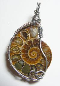 Wire Wrapped Ammonite Pendant by EcoTomeExclusives. All rights reserved.