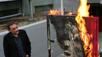 Antonio Manfredi burning art at the Casoria Contemporary Art Museum