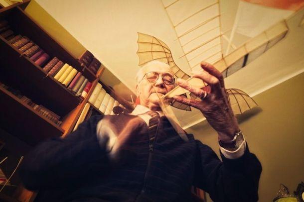 Artist Luigi Prina prepping one of his flying ships for flight.